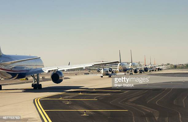commercial jets waiting in ,line - taxiing stock pictures, royalty-free photos & images