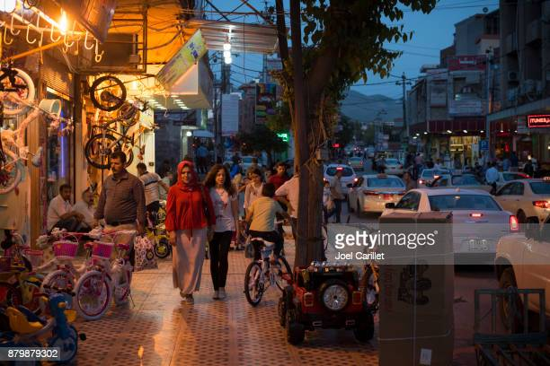 commercial life in kurdish city of sulaymaniyah, iraq - iraqi woman stock photos and pictures