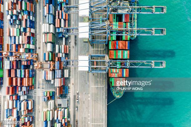 commercial logistics industry. the containers is loaded / unloaded at kwai tsing container terminals of hong kong - global trade war stock pictures, royalty-free photos & images