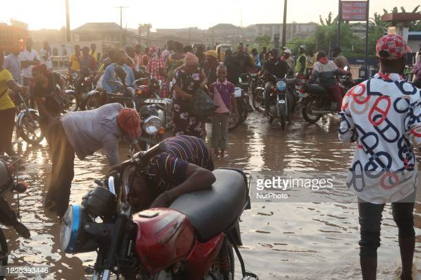 Commercial motorcyclists, popularly known as okada riders, stop work as flood takes over Ige Road, Aboru, Lagos. Flood disrupted movement and...