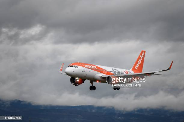 A commercial plane of lowcost carrier EasyJet is seen landing at Geneva Airport on March 11 2019 in Geneva