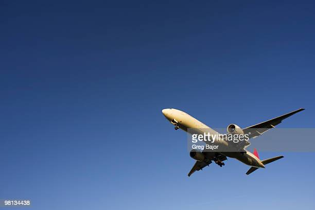 commercial plane - flying stock photos and pictures