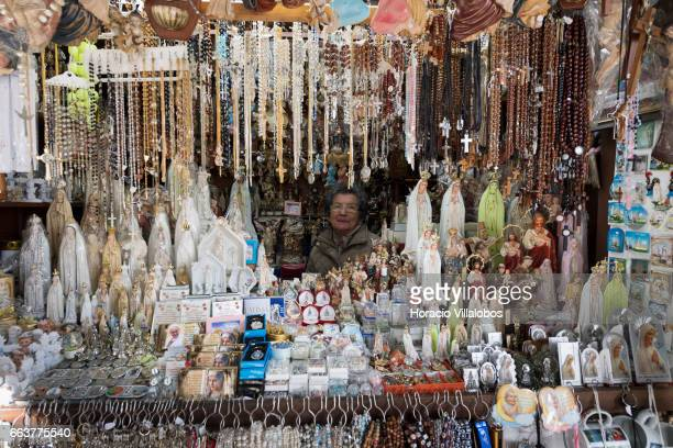 Commercial products related to religion are on display outside the Sanctuary of Fatima on April 1 2017 in Fatima Portugal Thousands of pilgrims and...
