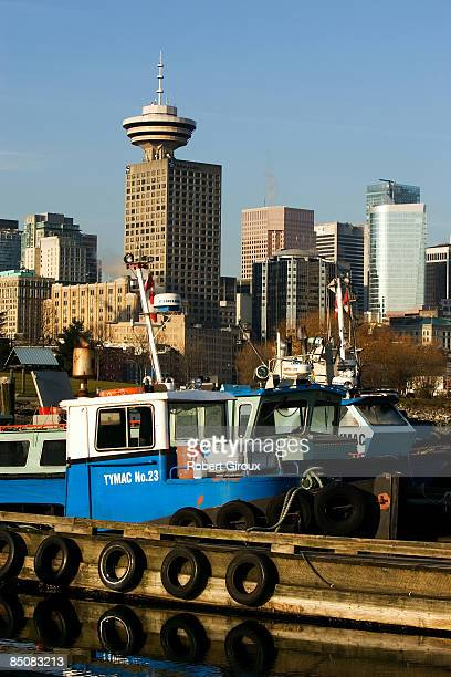 Commercial service boats are docked and the Harbour Center tower is seen in the background on February 18 2009 in Vancouver British Columbia Canada...