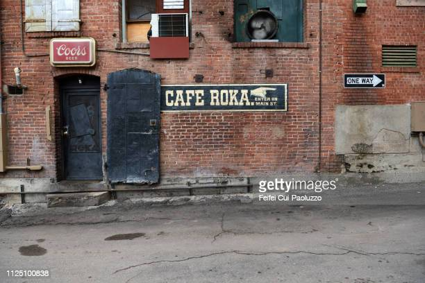 commercial sign and one way sign at bisbee, arizona, usa - feifei cui paoluzzo stock pictures, royalty-free photos & images