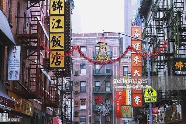 commercial sign in city street - chinatown stock pictures, royalty-free photos & images