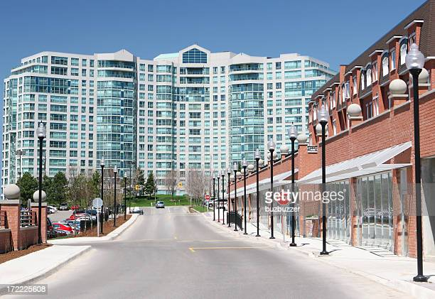 commercial street near a large apartment building - buzbuzzer stock pictures, royalty-free photos & images
