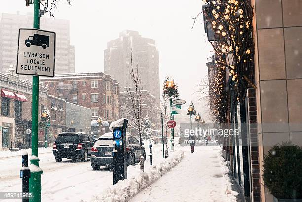 Commercial street under a snowfall, Montreal, Quebec, Canada, horizontal.