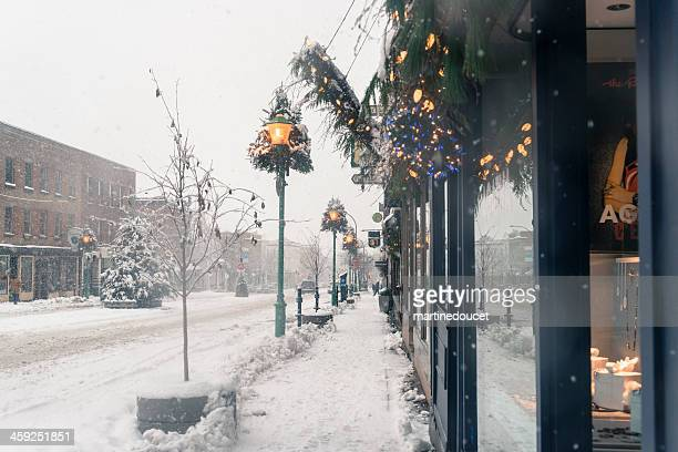 "commercial street under a snowfall, montreal, quebec, canada, horizontal. - ""martine doucet"" or martinedoucet stock pictures, royalty-free photos & images"