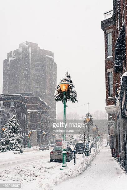 "commercial street under a snowfall, montreal, quebec, canada, vertical. - ""martine doucet"" or martinedoucet stock pictures, royalty-free photos & images"