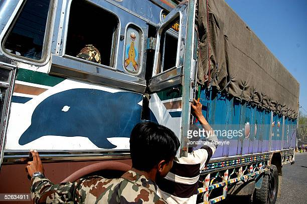 A commercial truck is filled with soldiers instead of goods February 27 2005 in the eastern Terai district of Hetauda Nepal The covert operation by...