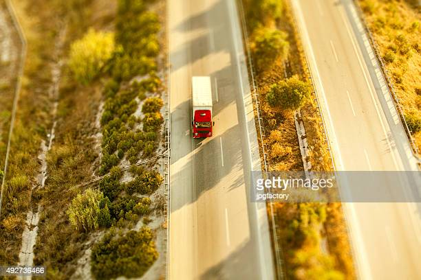 Commercial truck moving on highway - aerial view
