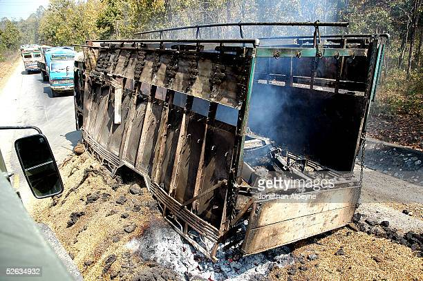 A commercial truck sits in the road after it was torched by raiding Maoists troops February 28 2005 in the eastern Terai district of Hetauda Nepal...