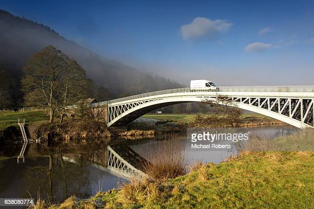 Commercial van crossing Bigsweir bridge over the river Wye near Monmouth