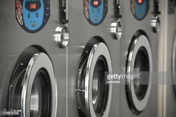 Commercial washing machines stacked on in a Laundromat