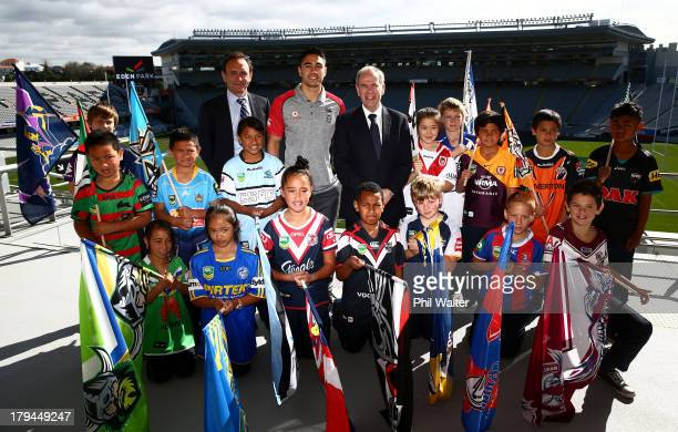 Commerical manger Paul Kind, Auckland Mayor Len Brown and Shaun Johnson of the Warriors pose for a photo with school children during the NRL Auckland...