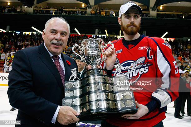 Commisioner David Branch awards the Memorial Cup to Harry Young of the Windsor Spitfires after the Windsor Spitfires defeated the Brandon Wheat Kings...