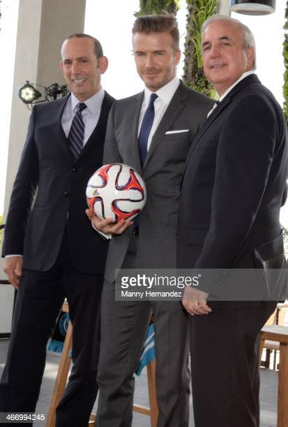 Commisioner Don Garber David Beckham and MiamiDade Mayor Carlos Gimenez attend a press conference to announce Major League Soccer plans at PAMM Art...