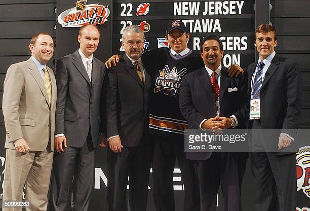 Commisioner Gary Bettman, unknown scout, Ross Mahoney, #1 overall draft pick Alexander Ovechkin, owner Ted Leonsis and George McPhee of the...