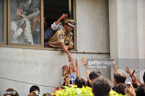 Commisioner of Police state of Andhra Pradesh AKKhan greets members of MajliseIttehadul Muslimeen as they gather outside the Owaisi Hospital in...