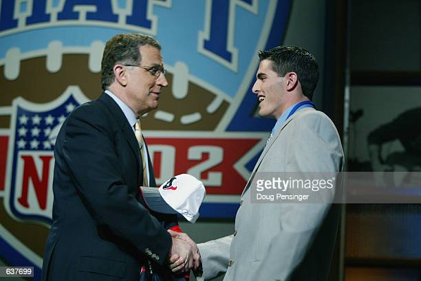 Commisioner Paul Tagliabue greets David Carr of Fresno State after Carr was chosen first overall by the Houston Texans in the NFL Draft at the...