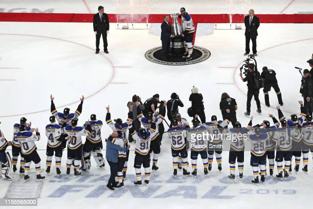 NHL commisoner Gary Bettman presents Alex Pietrangelo of the St Louis Blues with the Stanley Cup after defeating the Boston Bruins 41 to win Game...