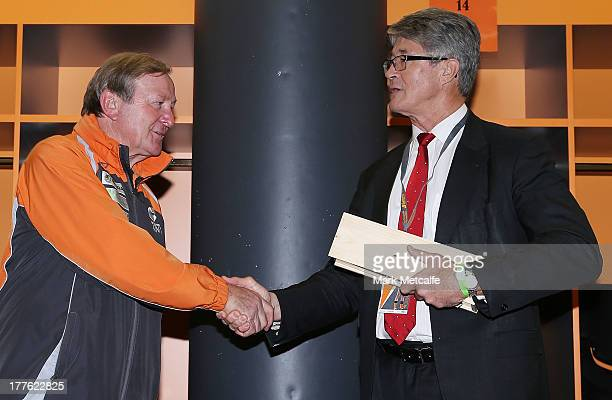 Commission Chairman Mike Fitzpatrick makes a presentation to Kevin Sheedy after his last match in Sydney as Head Coach of the Giants against Richmond...