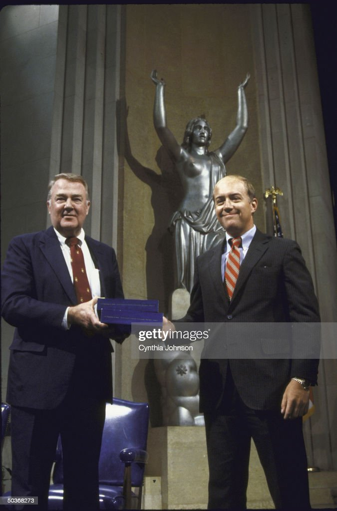 Commission of Pornography Chairman Henry Hudson (R), giving the US Atty. General Edwin Meese III the panel's report at the Justice Dept. press conf.