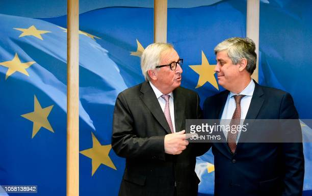EU Commission President Jean Claude Juncker embraces Mario Centeno President of the Eurogroup ahead of their meeting at EU headquarters in Brussels...