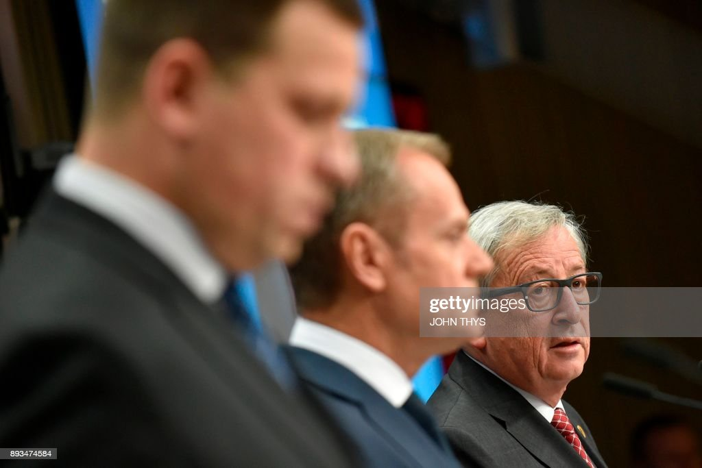 EU Commission President Jean Claude Juncker gives a joint press with Estonia's Prime Minister Juri Ratas (L) and European council President Donald Tusk (C), on second day of a European union summit in Brussels at the EU headquarters on December 15, 2017. /