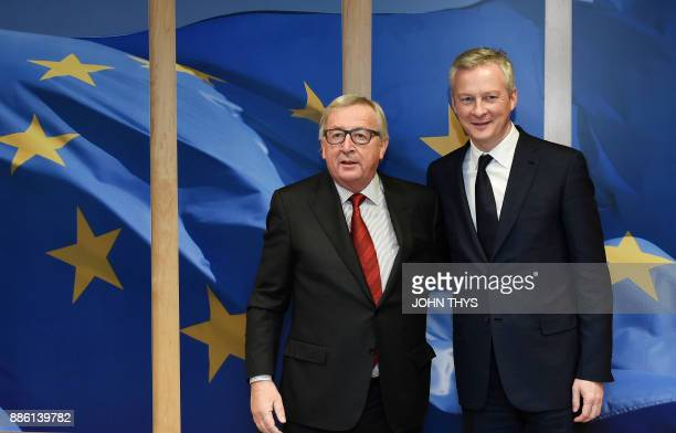 EU Commission President Jean Claude Juncker welcomes French Economy Minister Bruno Le Maire before their bilateral meeting at the EU Parliament in...