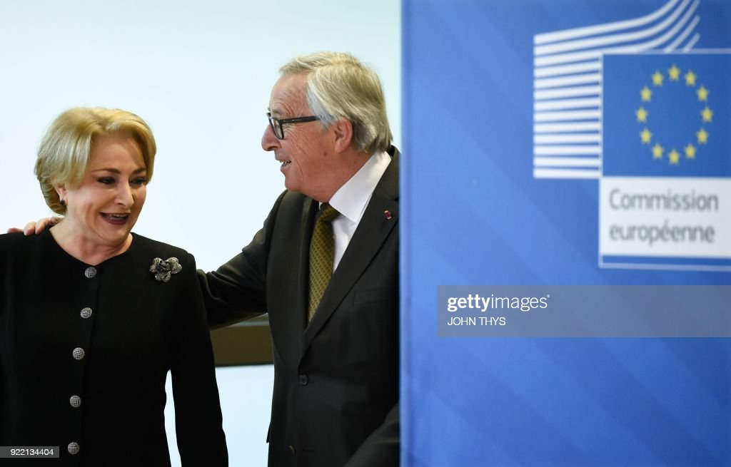 EU Commission President Jean Claude Juncker (R) welcomes Romanian Prime Minister Viorica Dancila before their bilateral meeting at the EU headquarters in Brussels on February 21, 2018. /
