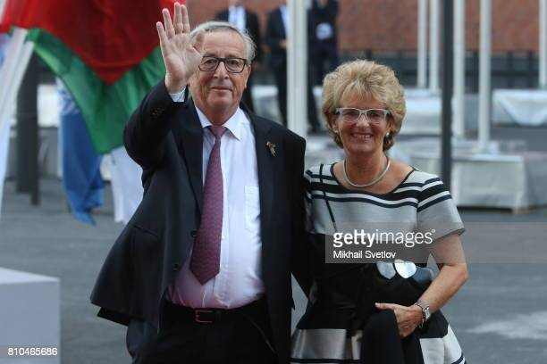EU Commission President JeanClaud Juncker and his wife Christiane Frising R arrive to the Elbphilharmone for the dinner during the G20 Summit on...