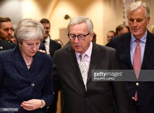 Commission President JeanClaude Juncker and EU chief Brexit negotiator Michel Barnier welcome Britain's Prime Minister Theresa May for Brexit talks...