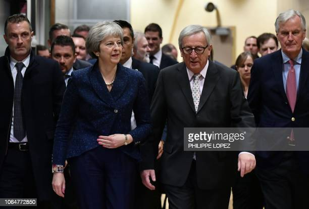 Commission President JeanClaude Juncker and EU chief Brexit negotiator Michel Barnier welcome Britain's Prime Minister Theresa May as she arrives for...
