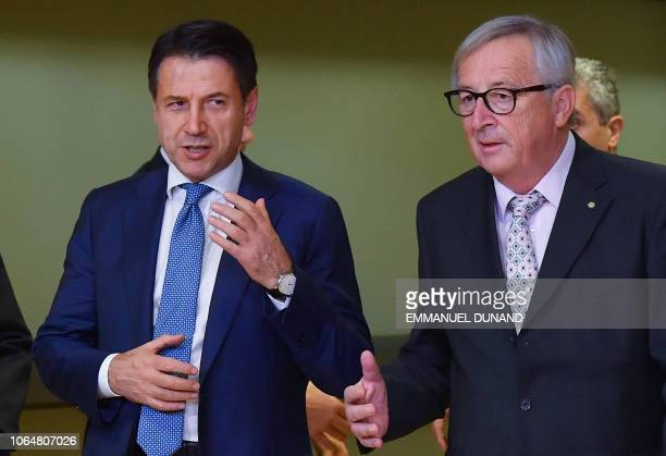 EU Commission President JeanClaude Juncker welcomes Italy's Prime Minister Giuseppe Conte as he arrives for a working dinner at the EU Headquarters...
