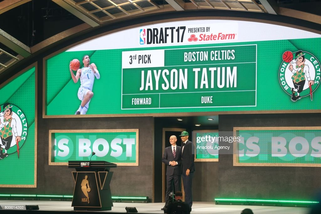 NBA commissioner Adam Silver (L) and Boston Celtics' pick Jayson Tatum (R) shake their hands during Draft 2017 in Barclays Center in Brooklyn borough of New York, United States on June 22, 2017.