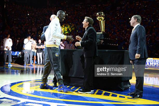 NBA commissioner Adam Silver and Golden State Warriors owners Joe Lacob and Peter Guber present the championship ring to Draymond Green of the Golden...