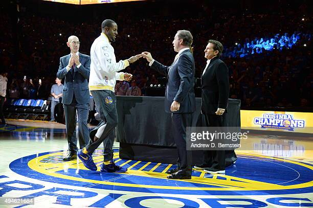 NBA commissioner Adam Silver and Golden State Warriors owners Joe Lacob and Peter Guber present the championship ring to Andre Iguodala of the Golden...