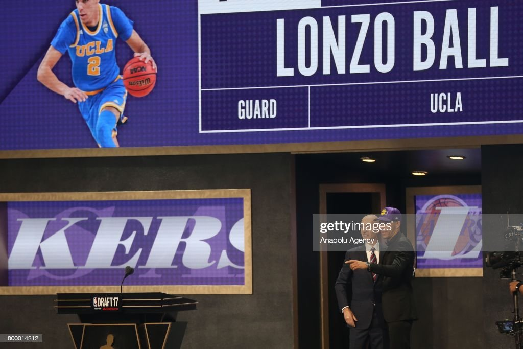 NBA commissioner Adam Silver (L) and Los Angeles Lakers' pick Lonzo Ball (R) shake their hands during Draft 2017 in Barclays Center in Brooklyn borough of New York, United States on June 22, 2017.
