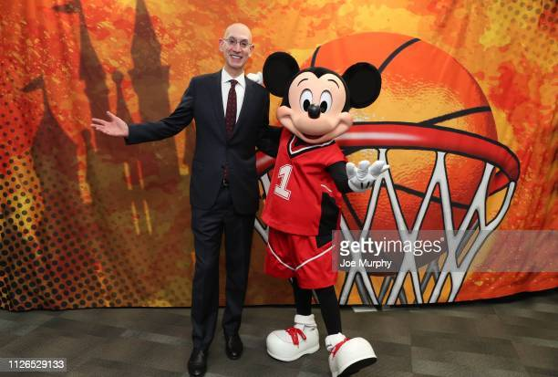 Commissioner Adam Silver and Mickey Mouse meet during NBA All Star Weekend in Charlotte North Carolina on February 15 2019 at Bojangles Coliseum The...