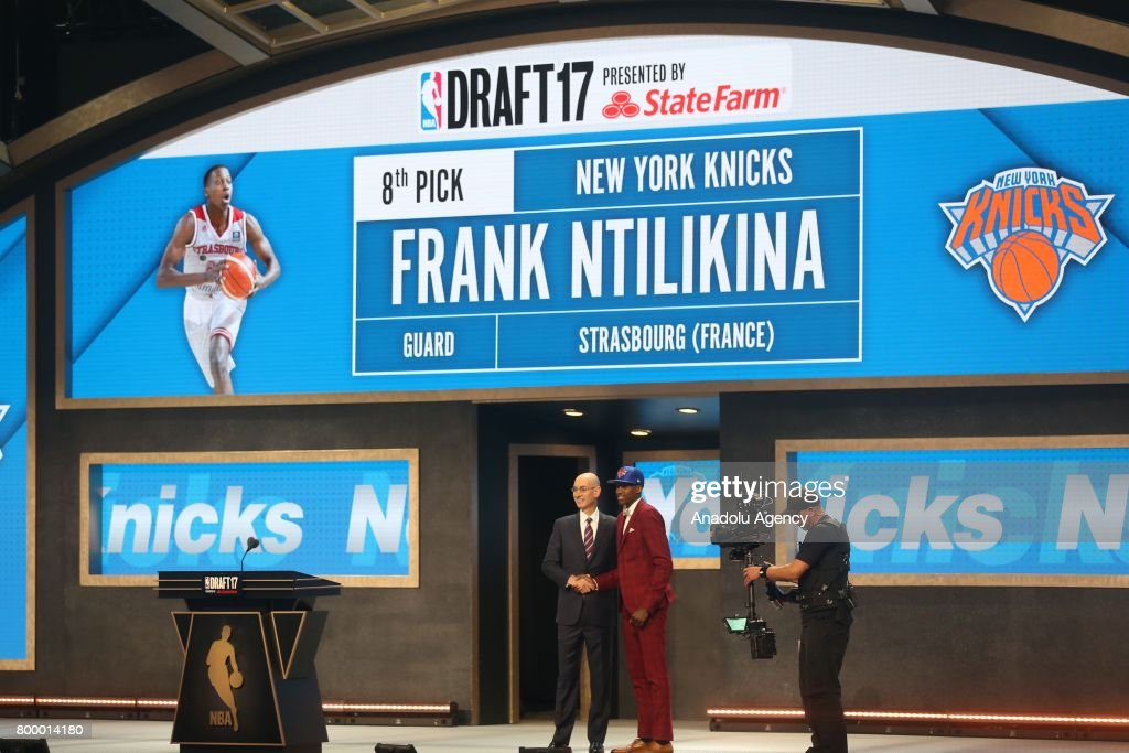 NBA commissioner Adam Silver (L) and New York Knicks' pick Frank Ntilikina (R) shake their hands during Draft 2017 in Barclays Center in Brooklyn borough of New York, United States on June 22, 2017.