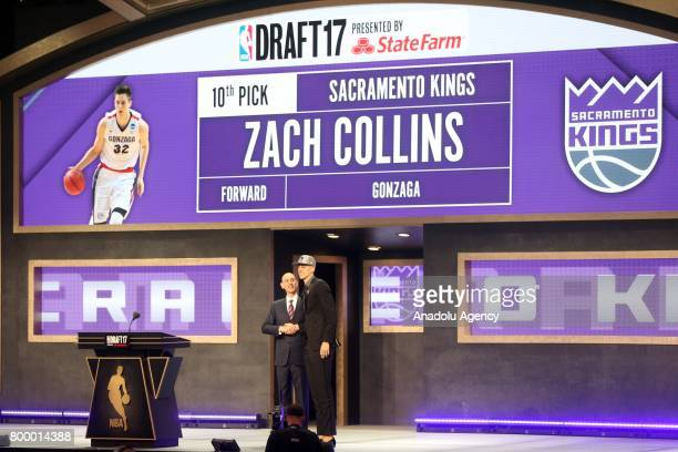 NBA commissioner Adam Silver and Sacramento Kings' pick Zach Collins shake their hands during Draft 2017 in Barclays Center in Brooklyn borough of...