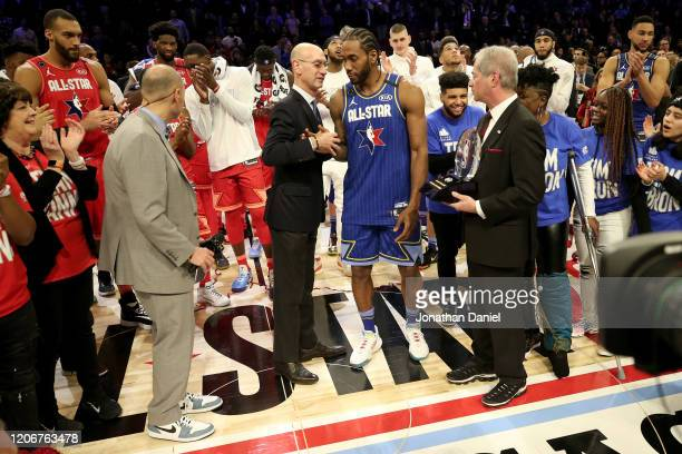 Commissioner Adam Silver congratulates Kawhi Leonard of Team LeBron after being named the Kobe Bryant MVP during the 69th NBA All-Star Game at the...