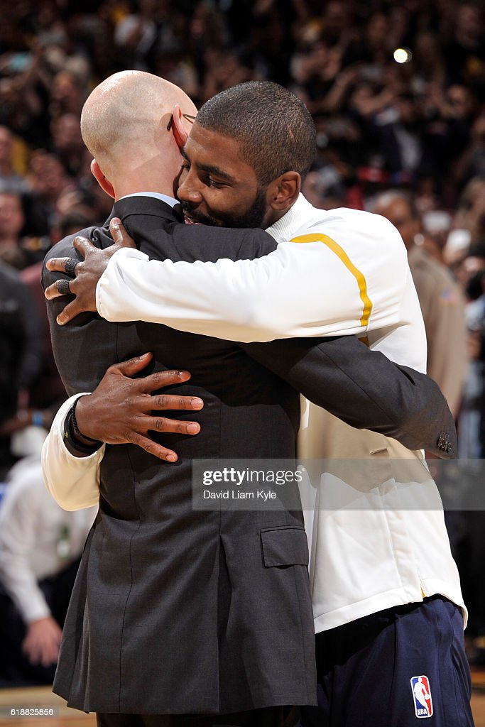 Commissioner, Adam Silver hugs Kyrie Irving #2 of the Cleveland Cavaliers after presenting him with his championship ring before the game against the New York Knicks on October 25, 2016 at Quicken Loans Arena in Cleveland, Ohio.