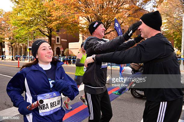 Commissioner Adam Silver is greeted by NBA Legend Chris Mullin as he finishes his leg in the 2014 NBA AllStar Relay during the TCS NYC Marathon on...