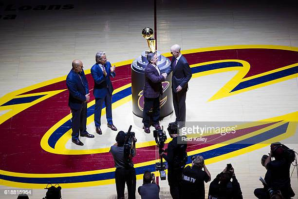 Commissioner Adam Silver presents the Owner of the Cleveland Cavaliers Dan Gilbert with his championship ring before the game against the New York...
