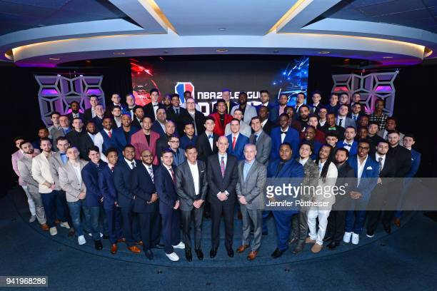 Commissioner Adam Silver TakeTwo Interactive CEO Strauss Zelnickand and Manging Director of the NBA2K League Brendan Donohue pose for a group photo...