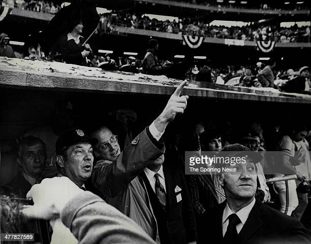 Commissioner Bowie Kuhn gestures as he looks on from the Oakland in Athletics dugout during the 1972 World Series against the Cincinnati Reds on...