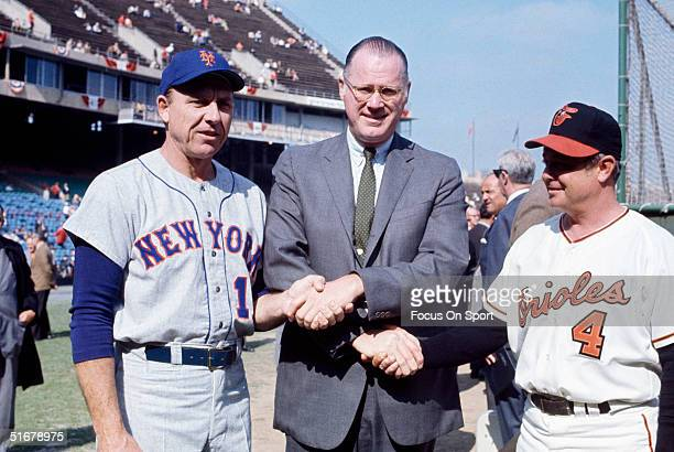 Commissioner Bowie Kuhn shakes hands with Mets' manager Gil Hodges and Orioles' manager Earl Weaver during the 1969 World Series at Memorial Stadium...
